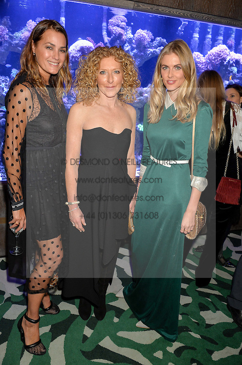 Left to right, YASMIN LE BON, KELLY HOPPEN and DONNA AIR at a dinner hosted by Creme de la Mer to celebrate the launch of Genaissance de la Mer The Serum Essence held at Sexy Fish, Berkeley Square, London on 21st January 2016.