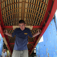 Kieran Clancy from West Clare Currachs with some of the Currachs they made at their work shops in Kilkee. Pic Sean Curtin Press 22