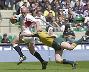 24/05/2002<br /> Sport - Rugby Union<br /> IRB World Sevens Series - Twickenham<br /> Ben Petersens tackle, fails to stop the run of England sevens captain, Phil Greening as he moves towards the try line to score a second half try. <br />    [Mandatory Credit, Peter Spurier/ Intersport Images]<br />    [Mandatory Credit, Peter Spurier/ Intersport Images]