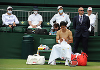 Tennis - 2021 All England Championship - Week One - Day Four (Thursday) - Wimbledon<br /> Kei Nishikori v Jordan Thompson<br /> <br /> Kei Nishikori of Japan changes his shirt, watched by his coaches<br /> <br /> CreditCOLORSPORT/Andrew Cowie