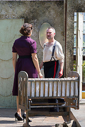 Pictured:  <br />Bard in the Botanics . The latest production features a version of Macbeth set in 1950s, directed by Gordon Barr. Kirk Bage (Macbeth) and Nicole Cooper (Lady Macbeth) have blood on their hands as they perform the murder of Duncan scene on the main stage<br />Karen Gordon  (c) Edinburgh Elite media Date<br /><br /><br />(c) Karen Gordon   Edinburgh Elite media