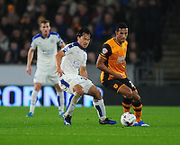 Hull City's Isaac Hayden shields the ball from Leicester City's Shinji Okazaki<br /> <br /> Photographer Chris Vaughan/CameraSport<br /> <br /> Football - Capital One Cup Round 4 - Hull City v Leicester City - Tuesday 27th October 2015 - Kingston Communications Stadium - Hull<br />  <br /> © CameraSport - 43 Linden Ave. Countesthorpe. Leicester. England. LE8 5PG - Tel: +44 (0) 116 277 4147 - admin@camerasport.com - www.camerasport.com