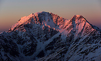 Russia, Caucasus, first red light on Nakratau (4269 m asl) (right) and Donguzorun (4468 m asl), seen from Elbrus.