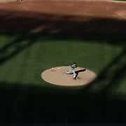 Detroit Tigers pitcher Max Scherzer pitching in the late afternoon sunshine as shadows fall on Citi Field during the New York Mets V Detroit Tigers Baseball game at Citi Field, Queens, New York. USA. 24th August 2013. Photo Tim Clayton