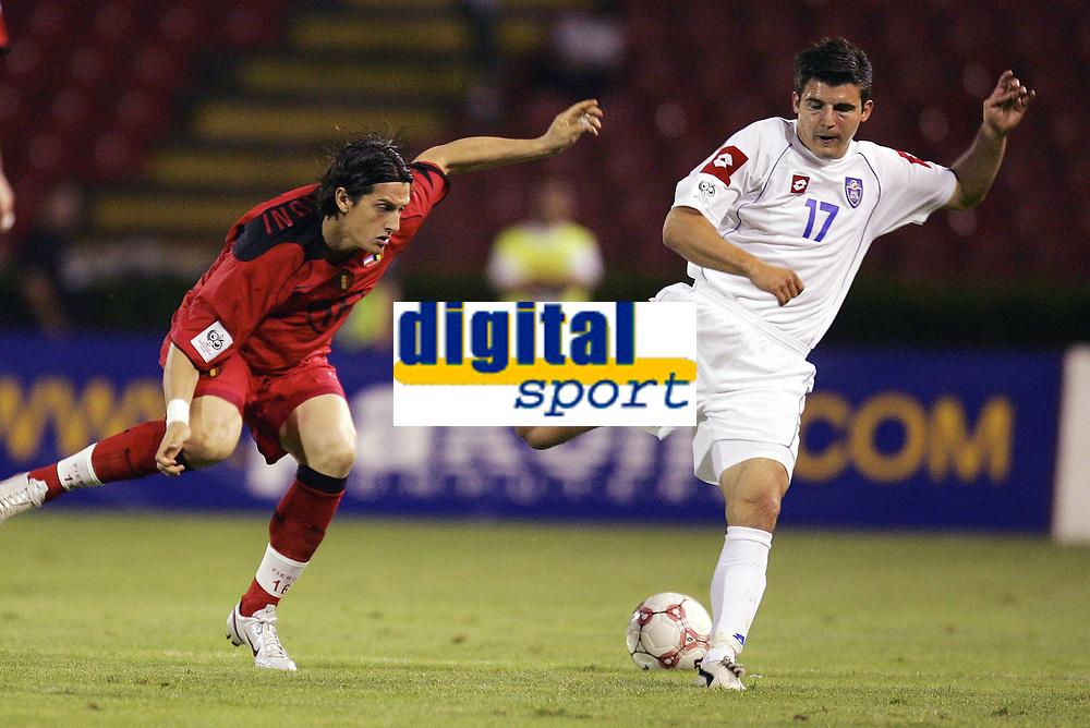 FOOTBALL - WORLD CUP 2006 - QUALIFYING ROUND - GROUP 7 - SERBIA MONTENEGRO v BELGIUM - 04/06/2005 - LUIGI PIERONI (BEL) / SIMON VUKCEVIC (SER) <br /> PHOTO PHILIPPE CROCHET /DIGITALSPORT