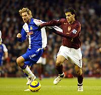 Photo: Chris Ratcliffe.<br />Arsenal v Blackburn Rovers. The Barclays Premiership.<br />26/11/2005.<br />Robbie Savage (L) battles with Cesc Fabregas