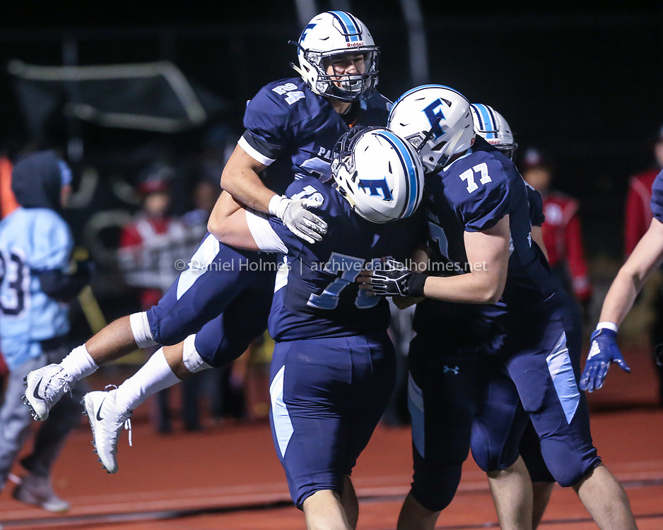 (11/8/19, FRANKLIN, MA) Franklin players lift Owen Palmieri's after his touchdown during the Div. 1 South football semifinal against Brockton at Franklin High School on Friday. [Daily News and Wicked Local Photo/Dan Holmes]