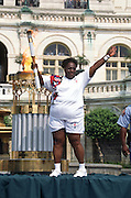 The Olympic torch is carried to the US Capitol building as part of the relay to the 1996 Summer Games in Atlanta June 21, 1996 in Washington, DC.