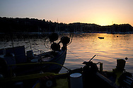 Fishing boats at sunset in Lakka harbour on the island of Paxos,The Ionian Islands, The Greek Islands, Greece, Europe