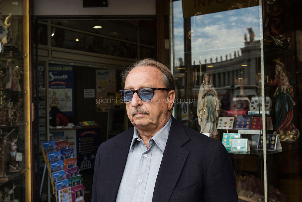 ROME, ITALY - 24 SEPTEMBER 2014: Lorenzo Savelli (75), owner of the Galleria Savelli religious store, poses for a portrait at the entrance oh his store in Rome, Italy, on September 24th 2014.<br /> <br /> The Vatican has announced that souvenir shops in Rome will no longer be allowed to sell plaques and parchments with papal blessings. Bishop Konrad Krajewski, the papal almoner, informed the shopkeepers in April that beginning on January 1, 2015, the papal blessings will only be available through at the Office of Papal Charities. All profits from the sale of these documents will go to the papal charities.