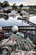 Lobster boats moored in New Harbor, Maine. The tiny picturesque pocket harbor is one of the last working harbors on the midcoast along the Pemaquid Peninsula