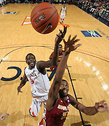 Dec. 30, 2010; Charlottesville, VA, USA; Virginia Cavaliers center Assane Sene (5) fights for the rebound with Iowa State Cyclones forward Melvin Ejim (3) during the game at the John Paul Jones Arena. Iowa State Cyclones won 60-47. Mandatory Credit: Andrew Shurtleff