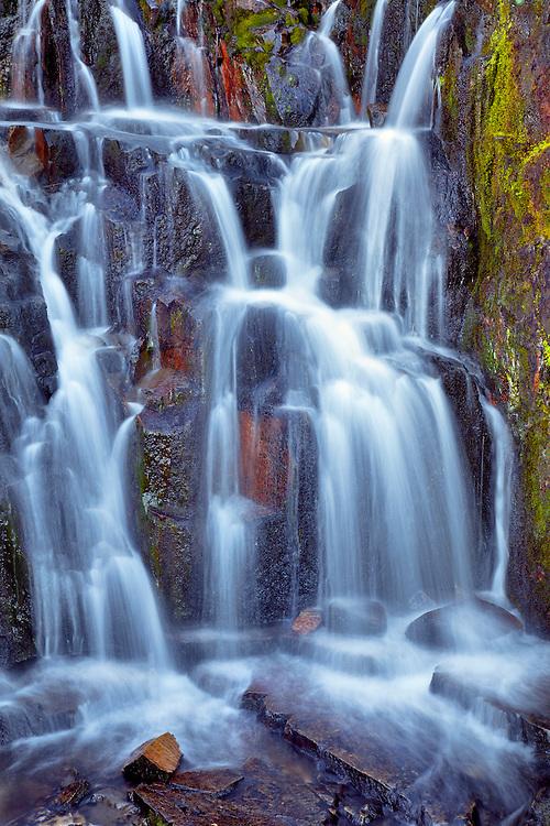 Sunbeam Creek cascades down a hillside in Mount Rainier NP, Washington.