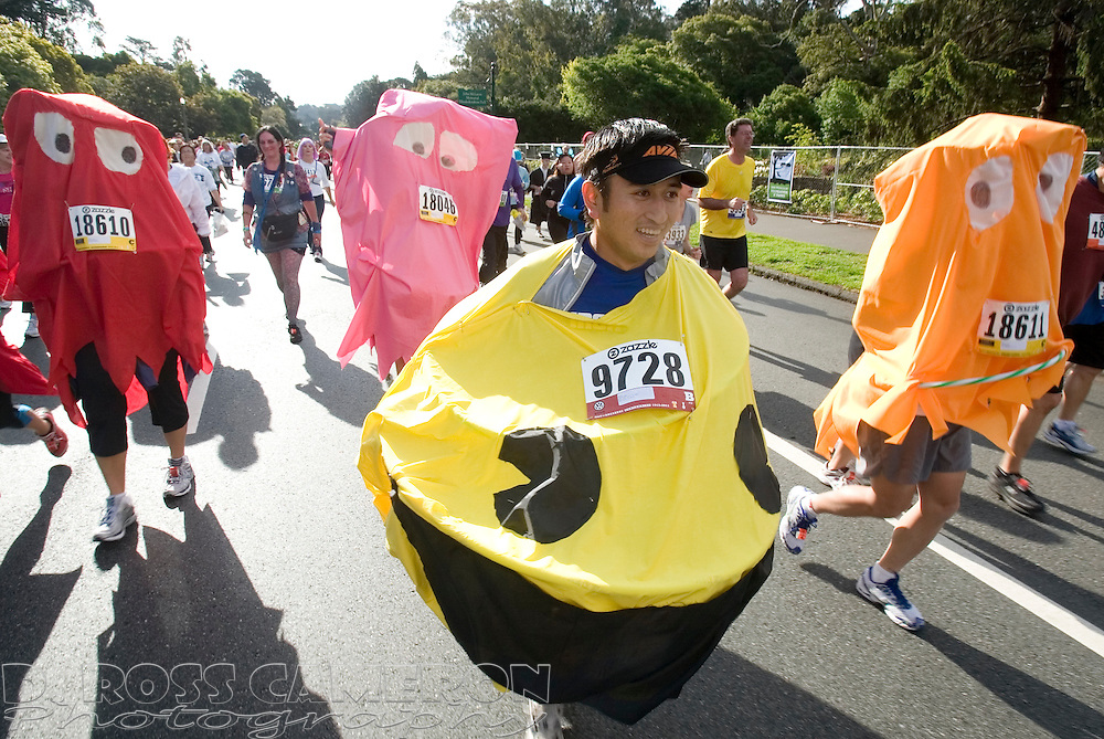 Jason Eng of San Diego, Calif., center, is the PacMan fleeing from ghosts Serina Kwok of San Diego, from left, Sherry Lin of Ontario, Calif. and Brian Quan of San Francisco, during the 100th running of the Bay to Breakers 12K, Sunday, May 15, 2011 in San Francisco. Photo by D. Ross Cameron)