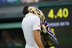 LONDON, ENGLAND - Wednesday, June 29, 2016: Novak Djokovic (SRB) wipes his face with a Wimbledon towel during the Gentlemen's Single 2nd Round match on day three of the Wimbledon Lawn Tennis Championships at the All England Lawn Tennis and Croquet Club. (Pic by Kirsten Holst/Propaganda)