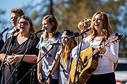 PARADISE, CA - NOVEMBER 08: A teacher and students with Ridgeview High School perform a song they wrote prior to the reveal of the Key Phoenix statue, during events for the one year anniversary of the Camp Fire, on November 8, 2019 in Paradise, California. It has been one year since the Camp Fire, caused by PG&E transmission lines, tore through the town of Paradise, California, killing 85 people and destroying more than 18,000 homes and businesses, becoming the deadliest and most destructive fire in the history of California. (Photo by Philip Pacheco/Getty Images)