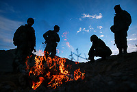 """ORUZGAN PROVINCE, AFGHANISTAN --  Soldiers of the newly formed Afghan National Army, 1ST Company of the First Battalion, Third  Brigade led into the Oruzgan Province by an A-TEAM with the 3rd Special Forces Group wake up in the early morning hours while sitting on a found weapons cache disclosed to them by the Oruzgan District Tribal Chief.  The ANA and the Special Forces team were able to implement their form of """"Afghan Diplomacy"""" and after two days the team was able to haul away nearly 10 tons of weapons and munitions from bunkers under the district chiefs compound. -- Photo by Jack Gruber, USA TODAY"""