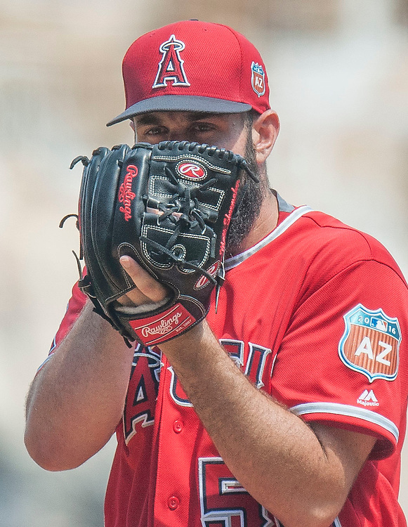 Starting pitcher Matt Shoemaker peers over his glove during the Angels' preseason game against the Chicago Cubs at Angel Stadium Sunday.<br /> <br /> <br /> ///ADDITIONAL INFO:   <br /> <br /> angels.0404.kjs  ---  Photo by KEVIN SULLIVAN / Orange County Register  --  4/3/16<br /> <br /> The Los Angeles Angels take on the Chicago Cubs at Angel Stadium during a preseason game at Angel Stadium Sunday.<br /> <br /> <br />  4/3/16