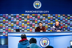 Bristol City Head Coach Lee Johnson takes part in the post match press conference at the Etihad Stadium as Head of Media Adam Baker looks on after a late 2-1 loss for his side - Rogan/JMP - 09/01/2018 - Etihad Stadium - Manchester, England - Manchester City v Bristol City - Carabao Cup Semi Final First Leg.