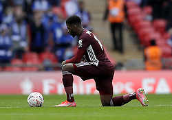 Leicester City's Kelechi Iheanacho takes a knee in support of the Black Lives Matter movement ahead of the Emirates FA Cup Final at Wembley Stadium, London. Picture date: Saturday May 15, 2021.