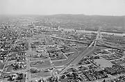 Y-750430B-18. aerial of Williams Ave. district after Emanuel demolitions. April 30, 1975