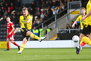 Burton Albion defender Kyle McFadzean (5) shoots at goal but his shot is saved by Accrington Stanley goalkeeper Jonathan Maxted (1) during the EFL Sky Bet League 1 match between Burton Albion and Accrington Stanley at the Pirelli Stadium, Burton upon Trent, England on 23 March 2019.