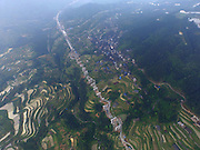 SANJIANG, May 5, 2016 <br /> <br /> Photo taken on May 5, 2016 shows terrace fields and a highway under construction in Sanjiang Dong Autonomous County, south China's Guangxi Zhuang Autonomous Region. <br /> ©Exclusivepix Media
