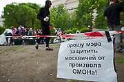 """Moscow, Russia, 12/05/2012..A poster reading """"Ask the mayor to protect Moscow people from the OMON riot police"""" in Chistiye Prudy, or Clean Ponds, a park in central Moscow were some 200 opposition activists have set up camp."""