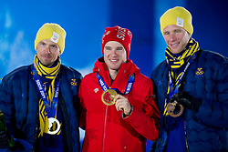 14.02.2014, Olympic Park, Adler, RUS, Sochi, 2014, Medaillenfeier Herren Langlauf, 15 km, im Bild Johan Olsson (SWE), Dario Cologna mit Goldmedaille, Daniel Richardsson (SWE) // during Mens Cross Country 15km Medal Ceremony of the Olympic Winter Games Sochi 2014 at the Olympic Park in Adler, Russia on 2014/02/14. EXPA Pictures © 2014, PhotoCredit: EXPA/ Freshfocus/ Urs Lindt<br /> <br /> *****ATTENTION - for AUT, SLO, CRO, SRB, BIH, MAZ only*****