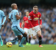Manchester City's Vincent Kompany tussles with Manchester United's Wayne Rooney<br /> <br /> - Barclays Premier League - Manchester City vs Manchester Utd - Etihad Stadium - Manchester - England - 2nd November 2014  - Picture David Klein/Sportimage