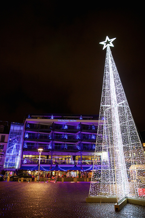 Christmas star and tree lights glowing in front of the Royal Yacht Hotel at the Wighbridge Square in St Helier, Jersey