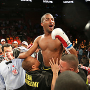 """Rances """"Kid Blast"""" Barthelemy celebrates his victory over Argenis Mendez during the """"Judgement Day"""" boxing event at American Airlines Arena on Thursday, July 10, 2014 in Miami, Florida.  Barthelemy won the fight after 12 rounds. (AP Photo/Alex Menendez)"""