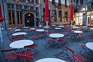 curfew from 9 pm during corona pandemic lockdown on May 5th. 2021. Empty tables and no people in front of the restaurant Brauhaus Frueh near the cathedral, Cologne, Germany.<br /> <br /> Ausgangssperre ab 21 Uhr waehrend des Corona Lockdowns am 5. Mai 2021. Leere Tische und keine Menschen am Brauhaus Frueh nahe Dom, Koeln, Deutschland.