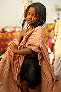 A young girl gets changed after her bath.