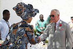 The Prince of Wales talks with a guest during a visit to Osu Castle, also known as Fort Christiansborg in Accra, Ghana, on day four of his trip to west Africa with the Duchess of Cornwall.