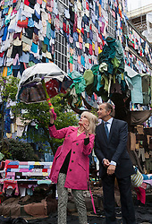 © licensed to London News Pictures. London, UK 26/04/2012. Joanna Lumley and Marc Bolland (CEO of M&S) posing in a street covered with clothes from walls, the road, and the pavement to a fabric-strewn bench, car and even a dog to illustrate future uses for old clothes in Brick Lane. M&S will be accepting people's old and unwanted clothes for their charity campaign with Oxfam. Photo credit: Tolga Akmen/LNP