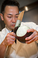 Master chef Keita Tarikino is working on an eggplant with his usuba knife. The usuba knife type is used for cutting vegetables.<br /> <br /> Restaurant Kappou Ukai in Ginza, Tokyo