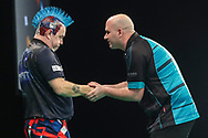 Peter Wright and Rob Cross at the end of their match during the Unibet Premier League darts at Motorpoint Arena, Cardiff, Wales on 20 February 2020.