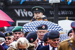 November 11, 2018 - Doncaster, Yorkshire, UK - Doncaster UK. A little boy watches the Service of remembrance at the Cenotaph in Doncaster to mark the 100th anniversary of the end of the First World War. (Credit Image: © Andrew Mccaren/London News Pictures via ZUMA Wire)