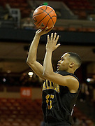 Jeremiah Jefferson (15) of Dallas Triple A Academy shoots the ball against El Paso Harmony Science Academy during the UIL Conference 1A semifinals at the Frank Erwin Center in Austin on Thursday, March 7, 2013. (Cooper Neill/The Dallas Morning News)