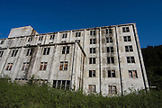 """The Buckner Building, Whittier, Alaska - """"A city under one roof"""". Built in 1953, this derelict building was abandoned but can't be demolished due to the amount of asbestos inside. It was damaged by earthquake in  1964.....The strangest town in Alaska, Whittier - only reachable by tunnel or ship. It's a stop off point for Cruise ships, and the Alaska raildroad. 90% of inhabitants live in one building! Originally established as a military base during World War two."""