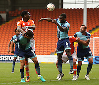 Blackpool's Armand Gnanduillet battles with Wycombe Wanderers' Joe Jacobson and Aaron Pierre (right) as the ball is delivered from a free kick<br /> <br /> Photographer Stephen White/CameraSport<br /> <br /> Football - The EFL Sky Bet League Two - Blackpool v Wycombe Wanderers - Saturday 20 August 2016 - Bloomfield Road - Blackpool<br /> <br /> World Copyright © 2016 CameraSport. All rights reserved. 43 Linden Ave. Countesthorpe. Leicester. England. LE8 5PG - Tel: +44 (0) 116 277 4147 - admin@camerasport.com - www.camerasport.com