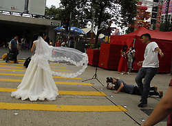 June 25, 2017 - Hong Kong, CHINA - A bride pose for the wedding photographer at the location in  Cenral where celebrations of 20th anniversary of Hong Kongs HANDOVER is going on. June 25, 2017.Hong Kong.ZUMA/Liau Chung Ren (Credit Image: © Liau Chung Ren via ZUMA Wire)