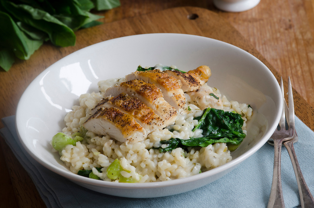 Grilled chicken breast with spinach and pea risotto