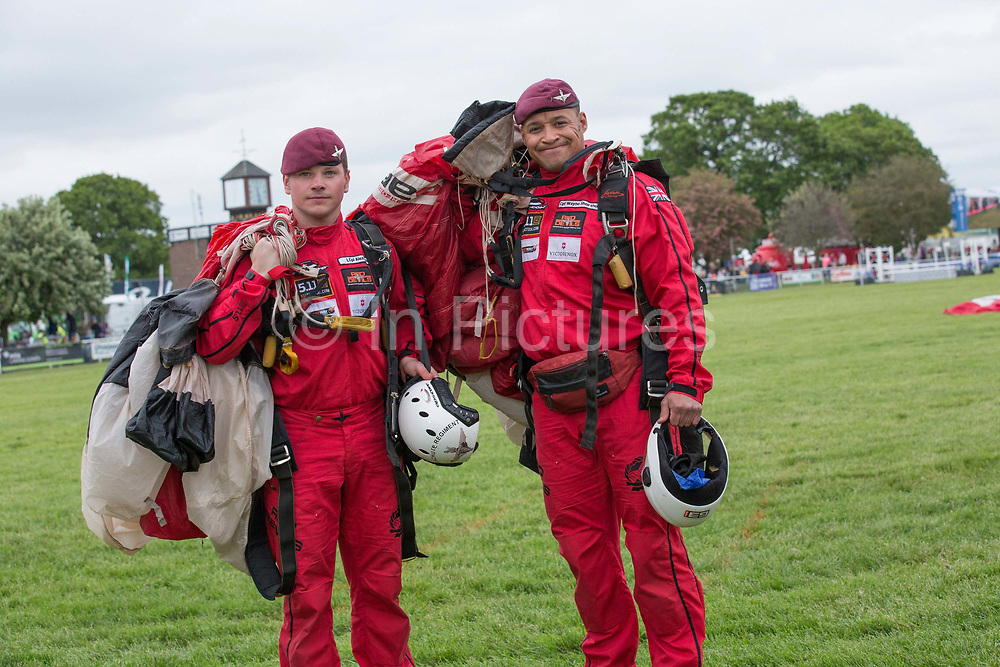 Two members from the Red Devils Army parachute display team at the Suffolk Show at the Suffolk Show Ground on the 29th May 2019 in Ipswich in the United Kingdom. The Suffolk Show is an annual show that takes place in Trinity Park, Ipswich in the English county of Suffolk. It is organised by the Suffolk Agricultural Association.