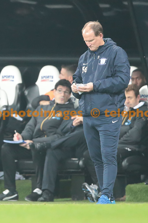 Preston North End manager Simon Grayson takes notes during the EFL Cup Round Four match between Newcastle United and Preston North End at St. James' Park in Newcastle. October 25, 2016.<br /> Nigel Pitts-Drake / Telephoto Images<br /> +44 7967 642437