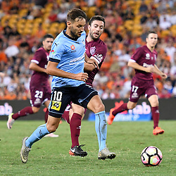 BRISBANE, AUSTRALIA - FEBRUARY 3: Milos Ninkovic of Sydney and Tommy Oar of the Roar compete for the ball during the round 18 Hyundai A-League match between the Brisbane Roar and Sydney FC at Suncorp Stadium on February 3, 2017 in Brisbane, Australia. (Photo by Patrick Kearney/Brisbane Roar)