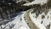 The area at the top of Teton Pass traditionally used by skiers to access the backcountry had only been partially plowed since early winter storms moved through the area over the weekend, allowing vehicles enough room to pull off and check brakes but not park where they usually would.