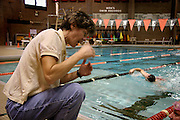 Swimming Coach Erin Hurley teaches front crawl technique to students in her triathlon training class in Obermiller pool.