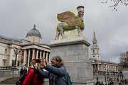 The 12th Fourth Plinth commission by the Mayor of London  artwork entitled The Invisible Enemy Should Not Exist by the artist Michael Rakowitz, in Trafalgar Square, on 29th March, 2018 in London, England. Started in 2006, the sculpture recreates over 7,000 archaeological artefacts looted from the Iraq Museum during the war there or destroyed elsewhere. Oneof these was Lamassu, a winged deity which guarded Nergal Gate at the entrance to the ancient city Assyrian city of Nineveh modern-day Mosul, Iraq which was destroyed by ISIS in 2015. The Lamassu, which had the same footprint as the Fourth Plinth is made of empty Iraqi date syrup cans, representative of a once-renowned industry.